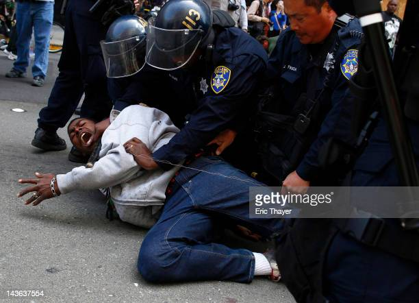 A protester is tased and detained by police during a rally for International Worker's Day on May 1 2012 in Oakland California Demonstrators have...