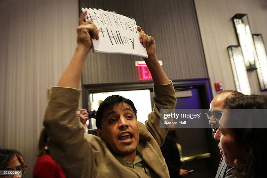 A protester is ushered out as Democratic presidential candidate Hillary Clinton speaks on stage before addressing the National Immigrant Integration Conference on December 14, 2015 in New York City. During the speech Clinton announced her immigration proposals if elected president. According to a new poll, in a hypothetical general election matchup Democratic front-runner Clinton would beat businessman and Republican Presidential candidate Donald Trump. The poll also places the former secretary of state in a tight race with Republican candidates Florida Sen. Marco Rubio and former neurosurgeon Ben Carson.