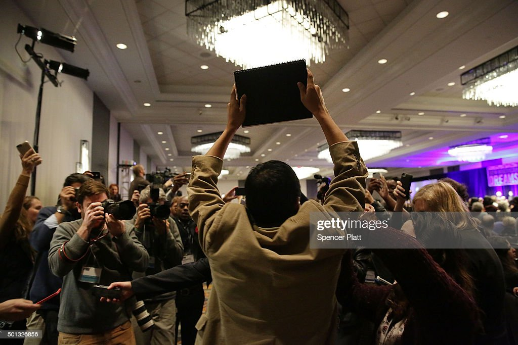 A protester is ushered out as Democratic presidential candidate Hillary Clinton speaks on stage before addressing the National Immigrant Integration Conference on December 14, 2015 in New York City.During the speech Clinton announced her immigration proposals if elected president. According to a new poll, in a hypothetical general election matchup Democratic front-runner Clinton would beat businessman and Republican Presidential candidate Donald Trump. The poll also places the former secretary of state in a tight race with Republican candidates Florida Sen. Marco Rubio and former neurosurgeon Ben Carson.
