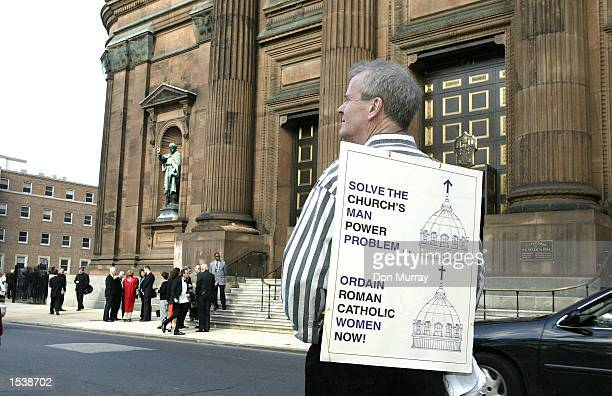 Protester Jay McClay a Catholic and a member of the reform group 'Call to Action' stands outside the Cathedral Basilica of Saints Peter and Paul...