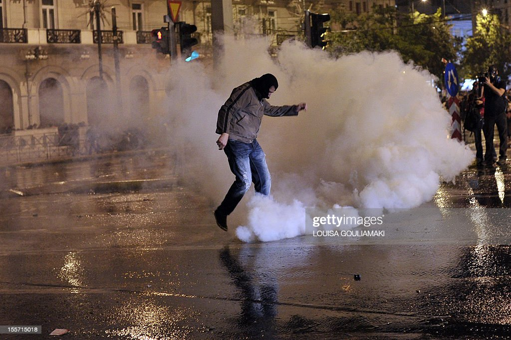 A protester kicks away a tear gas canister during a demonstration marking the second day of the 48-hours strike against new austerity measures, in Athens on November 7, 2012. Greek police today used tear gas to disperse demonstrators protesting outside parliament ahead of a key vote on a new round of austerity measures. Some protestors responded by hurling petrol bombs at police forces as the demonstration by some 70,000 people in Athens briefly flared up, an AFP correspondent reported.