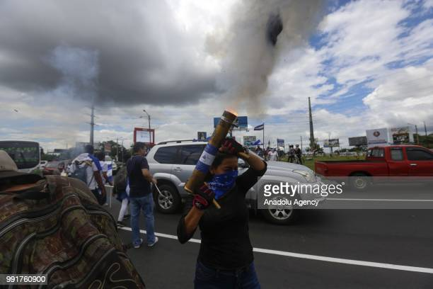 A protester launches a handmade bomb during a protest against Nicaraguan President Daniel Ortega's government in Managua Nicaragua on July 04 2018...