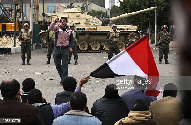 A protester leads fellow antigovernment demonstrators in chants against Egyptian President Hosni Mubarak in Tahrir Square on February 5 2011 in Cairo...