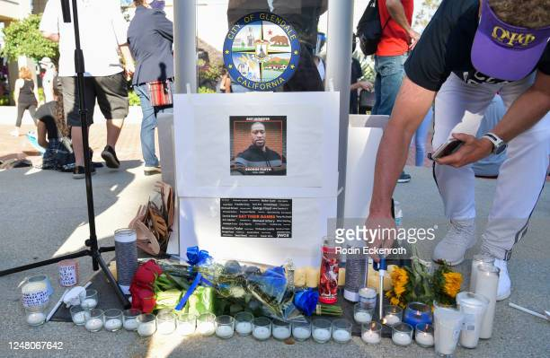 A protester lights candles at the George Floyd memorial at the Glendale Community March and Vigil for Black Lives Matter on June 07 2020 in Glendale...