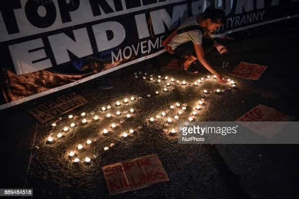 A protester lights candles during a demonstration condemning extrajudicial killings in Quezon city Metro Manila Philippines September 8 2017 On...