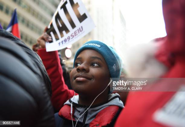 A protester looks on during a march on Martin Luther King Jr Day in Times Square called Rally Against Racism Stand Up for Haiti and Africa in New...