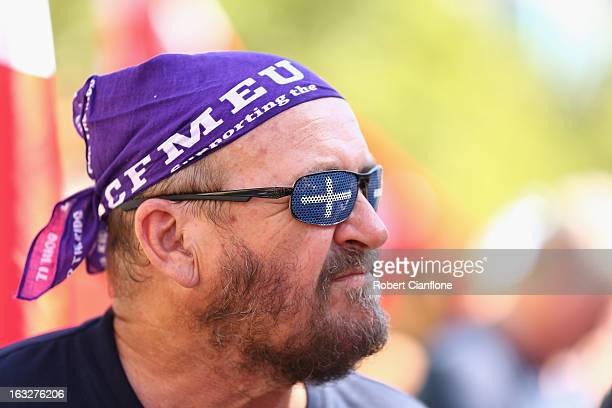 A protester looks on during a union organised protest against temporary worker visas on March 7 2013 in Melbourne Australia As Australia heads...