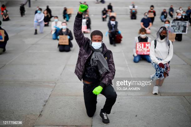 A protester makes a Black Lives Matter fist at a demonstration in Trafalgar Square in central London on June 5 to show solidarity with the Black...