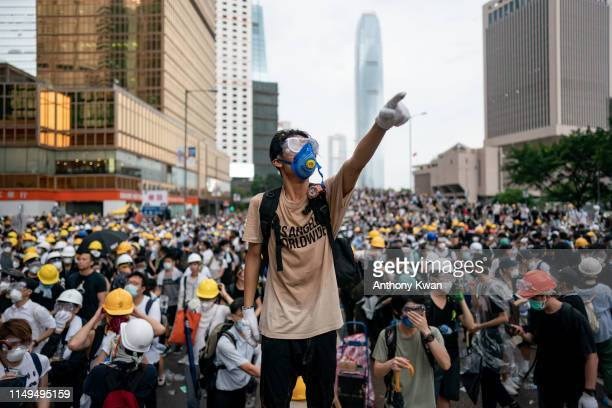 Protester makes a gesture during a protest on June 12, 2019 in Hong Kong China. Large crowds of protesters gathered in central Hong Kong as the city...