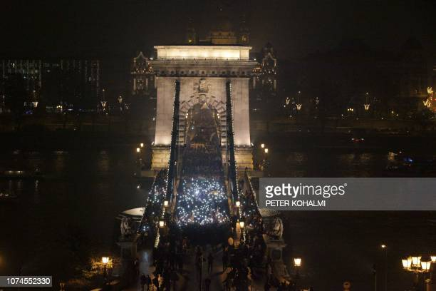 Protester march cross the oldest Hungarian bridge the Chain Bridge during their demonstration organised by nonparliamentary parties Momentum Movement...