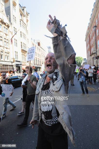 Protester marches against the Conservative party alliance with the DUP on Whitehall on June 10, 2017 in London, England. After a snap election was...