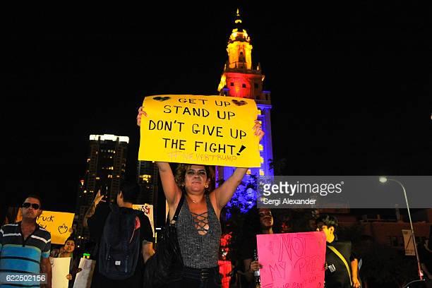 A protester marches at the antiTrump protest in downtown Miami on November 11 2016 in Miami Florida