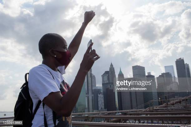 Protester marches during a rally in response to the police killing George Floyd on May 29, 2020 in Brooklyn in New York City. The group marched over...
