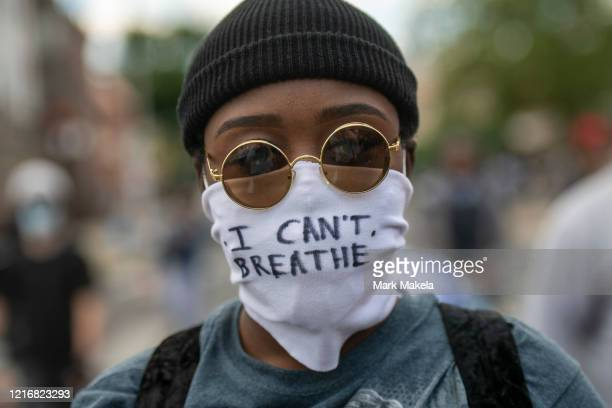 A protester marches with a cloth mask stating I CAN'T BREATHE in the aftermath of widespread unrest following the death of George Floyd on June 1...