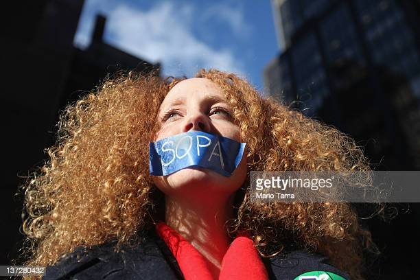 Protester Nadine Wolf demonstrates against the proposed Stop Online Piracy Act and Protect IP Act outside the offices of U.S. Sen. Charles Schumer...