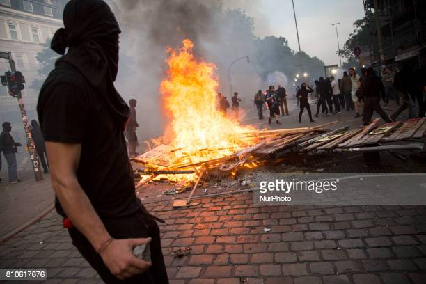 Protester near barricade during riots in St Pauli district during G 20 summit in Hamburg on July 8 2017 Authorities are braced for largescale and...