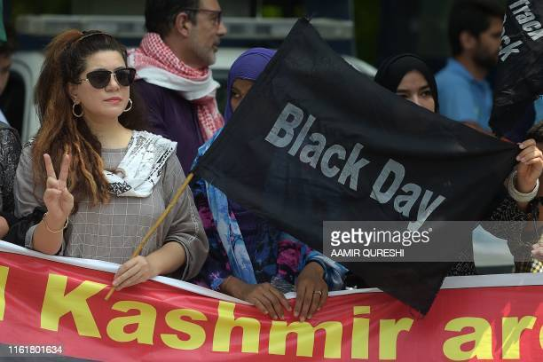 TOPSHOT A protester of the All Parties Hurriyat Conference holds a back flag near the Indian High Commission during a protest rally in Islamabad on...