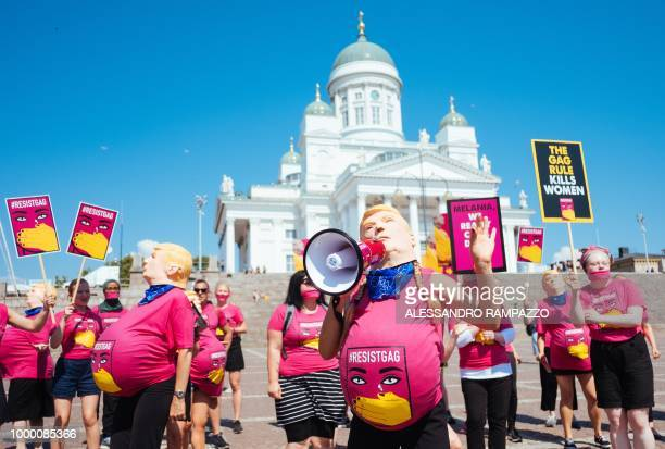 Protester of the #ResistGag movement wearing masks of US President Donald Trump stage a protest at the Senate square in Helsinki Finland on July 16...