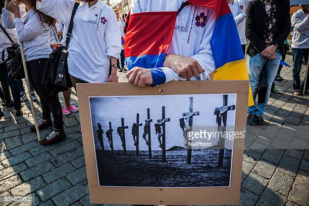 Protester on April 24 2015 with an armenian flag and photos of the armenian holocaust in the center of Prague during the demonstration in memory of...