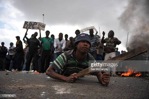 CONTENT] A protester on Modderfontein road in Ivory ParkPolice shot rubber bullets at protesters in Ivory Park near Tembisa yesterday 15 March 2010...