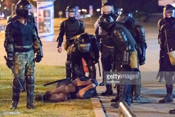 A protester on the ground before being arrested by the riot police during a public unrest in the streets of Minsk Belarus on August 9 2020 at the end...