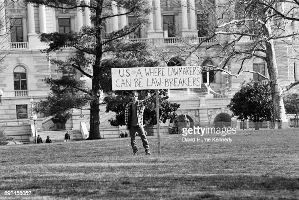 A protester outside the US Capitol building on the second to last day of the Senate Impeachment Trial of President Bill Clinton on Feb 11 1999 in...