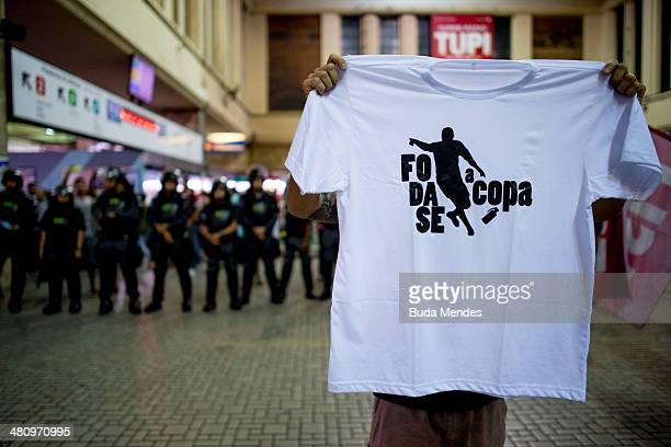 A protester participates in a demonstration against the 2014 FIFA World Cup Brazil at Central do Brasil train station on March 27 2014 in Rio de...