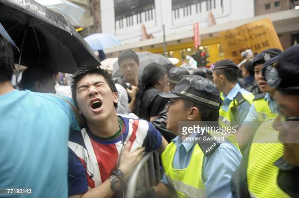 Protester passes out while struggling with the police against a barricade during the July 1 protest in wan chai. Protesters called for the...