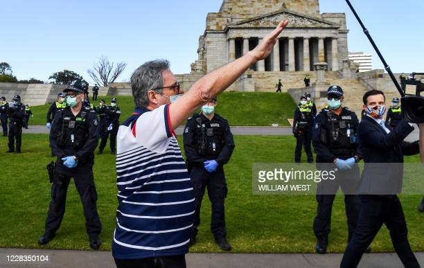Protester performs a Nazi salute at the Shrine of Remembrance in Melbourne on September 5, 2020 during an anti-lockdown rally protesting the state's...