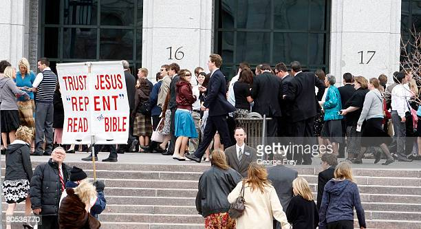 A protester pickets outside the Conference Center as mormons exit the first session of the 178th Annual General Conference of the Mormon Church April...