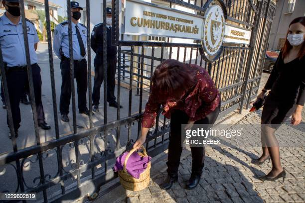 Protester places a picnic basket outside the presidency in the northern part of Nicosia, the capital of the self-proclaimed Turkish Republic of...