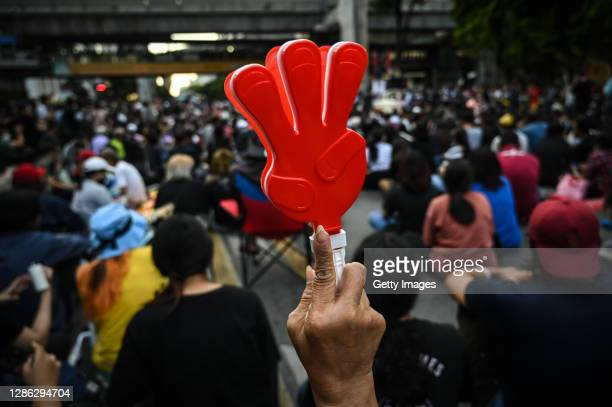 A protester plastic clapper in the shape of a three finger salute on November 18 2020 in Bangkok Thailand Prodemocracy protesters amassed at a key...