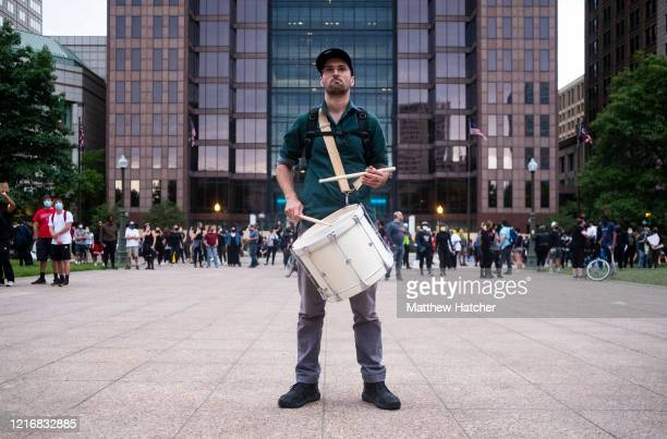Protester plays a drum shortly before a mass 'die-in' during a protest in front of the Ohio Statehouse on June 1, 2020 in Columbus, Ohio. Protesters...