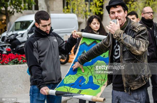 A protester points out a poster with the map of Europe to display the gas pipelines in project or realization phase Coinciding with the Summit in...