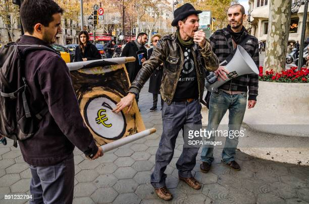 A protester points out a sign with the Euro symbol in reference to economic speculation on energy Coinciding with the Summit in Paris One Planet...