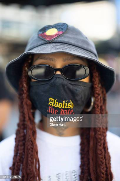 Protester poses for a portrait during a rally at King George Square on April 10, 2021 in Brisbane, Australia. The national day of action marks 30...