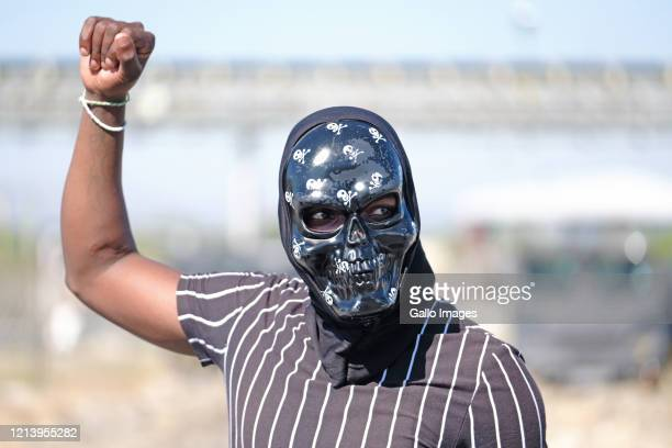 Protester poses wearing a skull mask on May 18, 2020 in Rustenburg, South Africa. Seraleng residents gathered at Sibanye k5 mine shaft and it is...