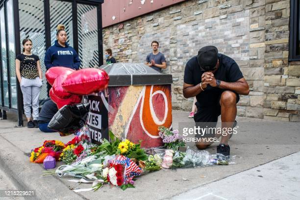 A protester prays in front of the memorial of George Floyd who died in custody on May 26 2020 in Minneapolis Minnesota An FBI investigation is...