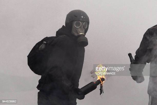 A protester prepares to throw a Molotov cocktail at riot forces as clashes erupt during a police operation to raze the decadeold camp known as ZAD at...