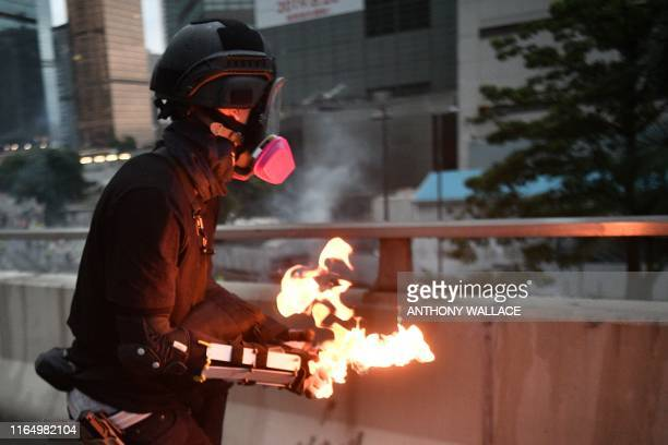 A protester prepares to throw a molotov cocktail towards police in the Admiralty area of Hong Kong on August 31 2019 Thousands of prodemocracy...