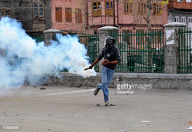 CONTENT] A protester prepares to throw a teargas at Indian security forces during a protest in old city Srinagar