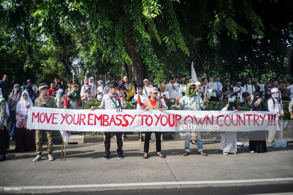 Protester raise a banner urged to move US embassy from