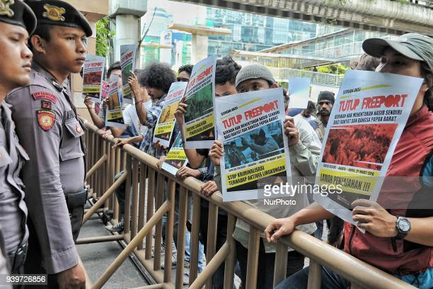 Protester raise a poster said close PT Freeport in front of Freeport office in Jakarta Indonesia on March 29 2018 Protesters from Indonesian people's...