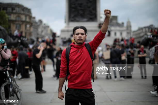 A protester raises a clenched fist during a Black Lives Matter protest in Trafalgar Square on June 3 2020 in London United Kingdom The death of an...