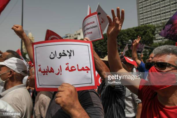 Protester raises a placard that reads in Arabic, the Muslim Brotherhood's Supreme in a terrorist group, during a demonstration held by the PDL party...