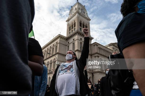 Protester raises his fist after a Breonna Taylor memorial march near Jefferson Square Park on March 13, 2021 in Louisville, Kentucky. Today marks the...