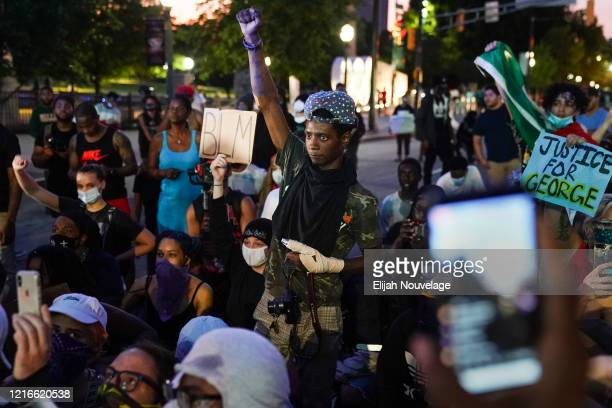A protester raises his fist during a demonstration on May 31 2020 in Atlanta Georgia Across the country protests have erupted following the recent...