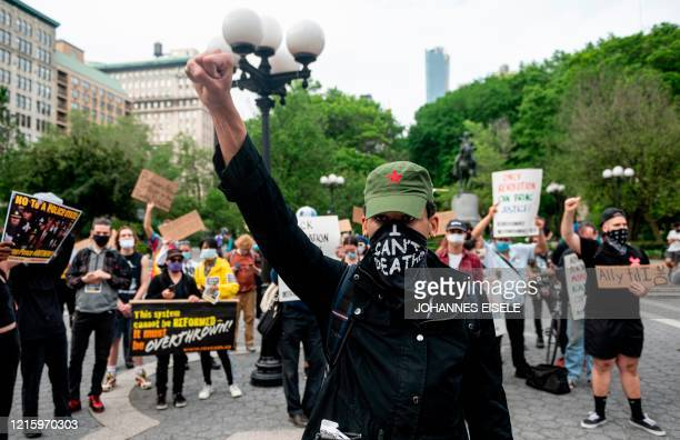 TOPSHOT A protester raises their fist during a Black Lives Matter demonstration on May 28 2020 in New York City in outrage over the death of a black...