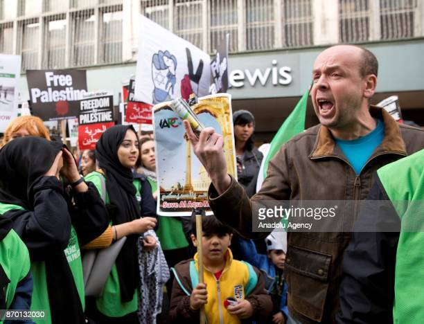 A protester reacts against proPalestinian supporters during a national march through central London England on November 4 2017 as they demand justice...