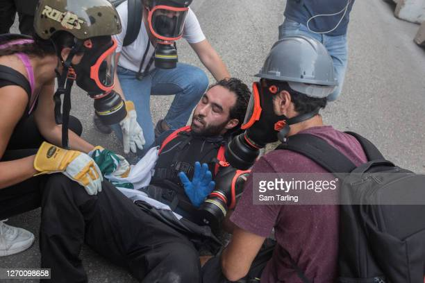 Protester recovers after being beaten by riot police at an anti-government demonstration in downtown Beirut, on September 1 in Beirut, Lebanon. This...
